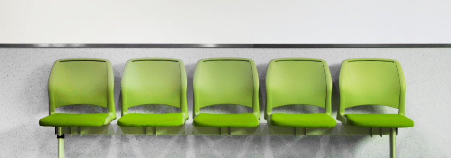 Lime green chairs attached to a wall. Photo credit: Canva.